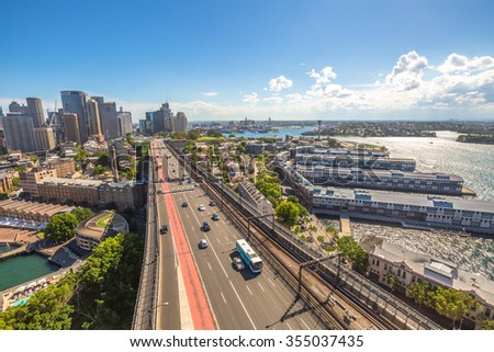 Sydney panorama with highway and subway, Australia. View from the Pylon Lookout located the southern eastern end of the Sydney Harbour Bridge. - stock photo