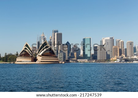 Sydney Skyline across the harbour from North Sydney, with city buildings and Opera House - stock photo