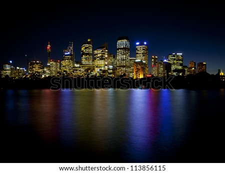 Sydney Skyline of the central business district with a reflections in the bay waters - stock photo
