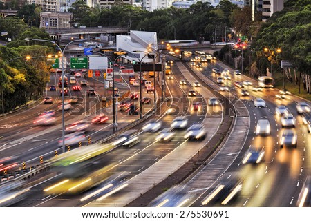 Sydney warringah freeway rush hour traffic with blurred head lights at sunset - stock photo