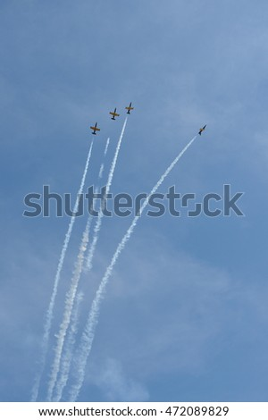 "SYKTYVKAR, RUSSIA - August 21, 2016: Aerobatic team ""Rus'"" on aero L-39 at the air show small and medium aviation in the Komi  Republic ""Aviaregion-2016"" devoted to 95-th anniversary of Komi Republic."