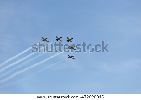 "SYKTYVKAR, RUSSIA - August 21, 2016: Aerobatic team ""Rus'"" on aero L-39 at the air show small and medium aviation in the Komi  Republic  ""Aviaregion-2016"" devoted to 95-th anniversary of Komi Republic"