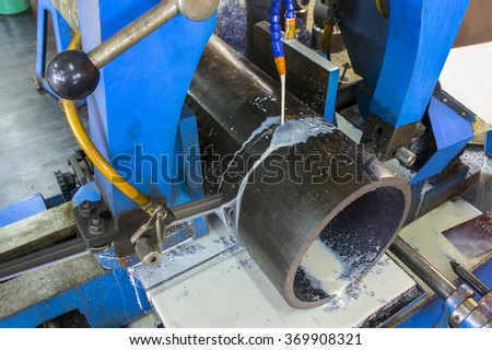 sylinder pipe cutting with power saw - stock photo