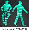symbol at green traffic lights for pedestrians and cyclists - stock photo