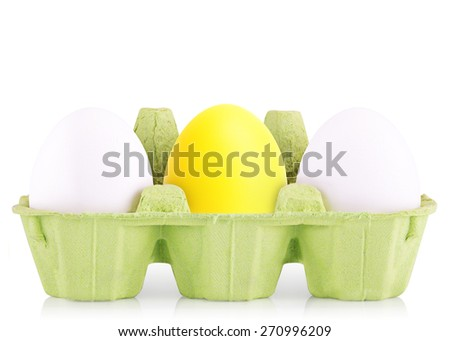 Symbol Concept white eggs isolated in box with yellow egg - stock photo