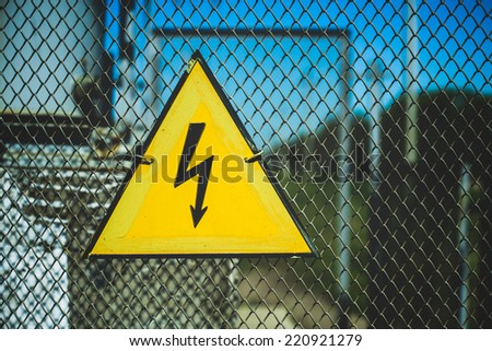 symbol electricity on the fence - stock photo