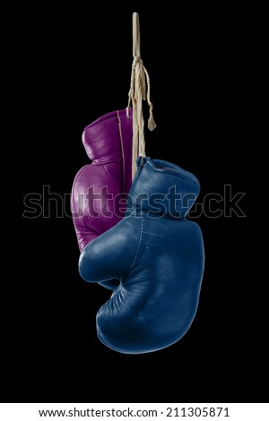 Symbol for Man and Woman Boxing with Pink & Blue Boxing Gloves - stock photo