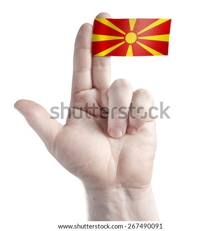 Symbol gun and victory - two fingers and flag of Macedonia - stock photo