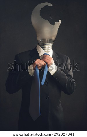 Symbol of a businessman with burn out syndrome - stock photo