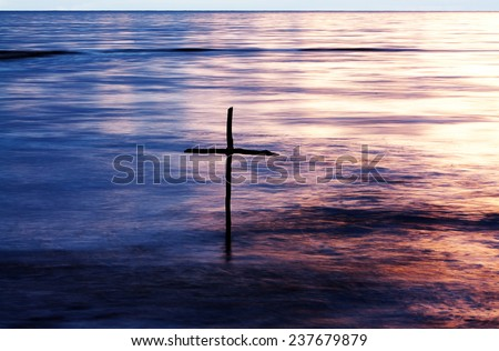 symbol of Baptism, a wooden cross in the Jordan River - stock photo