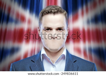 Symbol of censorship and freedom of speech: a young man without a mouth on a background of the national flag of Great Britain - stock photo