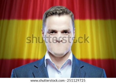 Symbol of censorship and freedom of speech: a young man without a mouth on a background of the national flag of Spain - stock photo