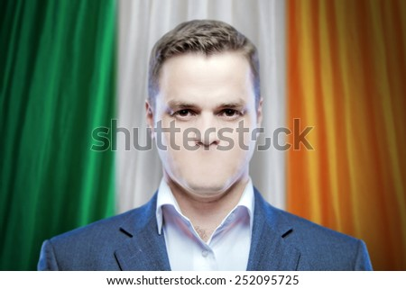 Symbol of censorship and freedom of speech: a young man without a mouth on a background of the national flag of Ireland - stock photo