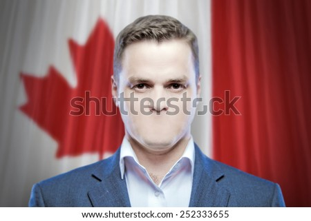 Symbol of censorship and freedom of speech: a young man without a mouth on a background of the national flag of Canada - stock photo