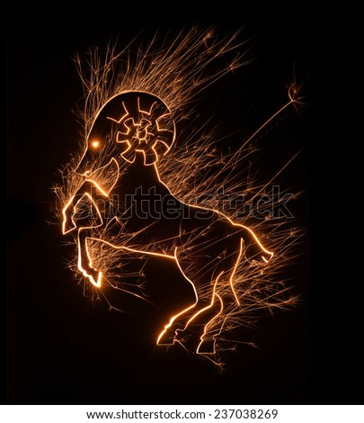 Symbol of Chinese zodiac ram in majestic stance set in sparkly design on black background. - stock photo