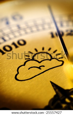 Symbol of cloudy weather on an old barometr - stock photo