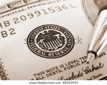 Symbol of Federal reserve system on dollar and pen. Finance system concept. - stock photo