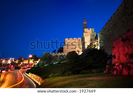 Symbol of Jerusalem - The ancient Tower of David at dawn with vehicle traffic