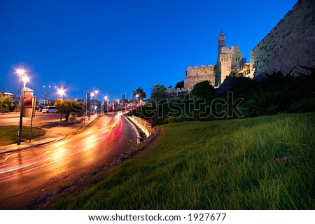 Symbol of Jerusalem - The ancient Tower of David at dawn with vehicle traffic - stock photo