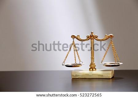 symbol of justice -a balance scales