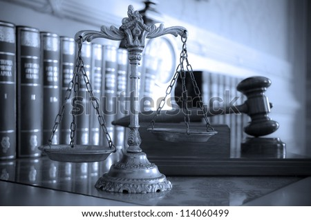 Symbol of law and justice on the table, law and justice concept, focus on the scales, blue tone - stock photo