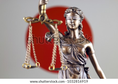 Symbol of law and justice with Japan Flag. Close up.