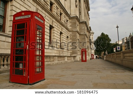 Symbol of London - Red phone booths near Whitehall in London.Great Britain. Photo taken on: September 20th, 2009 - stock photo