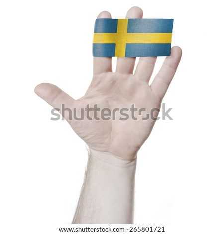 Symbol of national honor: the open palm of the hand with the flag of Sweden - stock photo