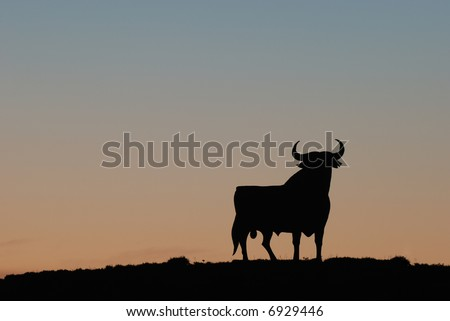 Symbol of southern Spain - the famous Black Bull at sunset - stock photo