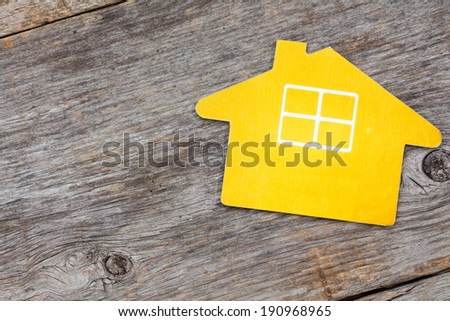 Symbol of the house  on wood background