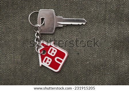 Symbol of the house with silver key  - stock photo