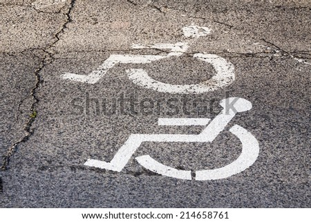 Symbol of the parking lot, no parking on site for a disabled person. Parking space for the disabled person. - stock photo