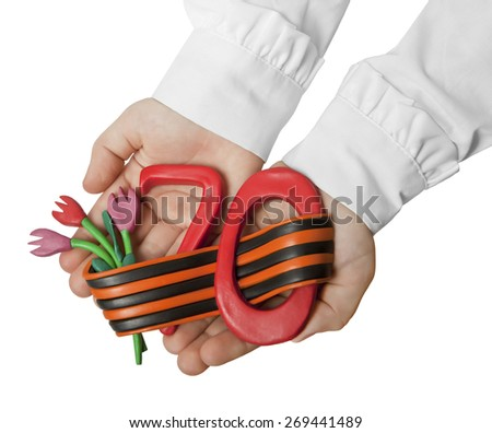 Symbol of Victory in the great Patriotic war , made by hands, lies on children's hands - stock photo