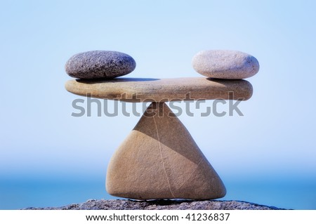 Symbol Scales is made of stones of various shapes - stock photo