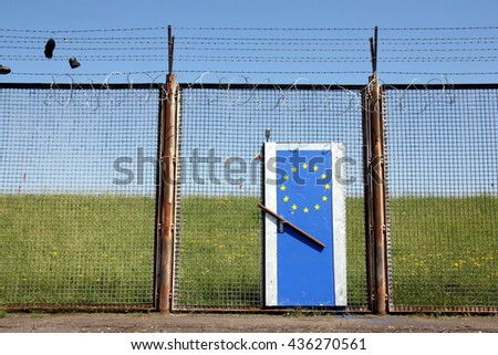 Symbolic European Border illustrating Europe's doors are closed (The barbed wire fence is not at the European border. It's a remainder of the former customs border of the harbour in Hamburg.) - stock photo