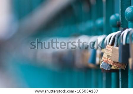 Symbolic love padlocks fixed to the railings of grunwaldzki  bridge, Wroclaw, Poland. - stock photo
