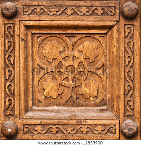 Symbolic patterns carved in wood - stock photo