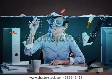 symbolic picture of a stressed female office worker and for stress at work - stock photo