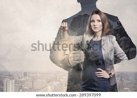 symbolic picture of the business people with a binoculars and fire - stock photo