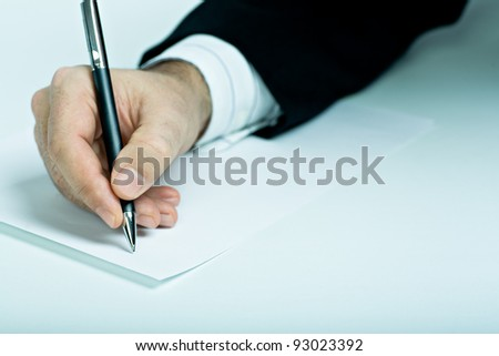 Symbolic picture. Suited man signing a contract. - stock photo