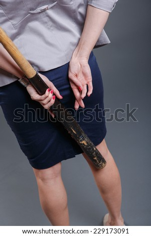 symbolic pictures of a decided and lying woman with baseball bat