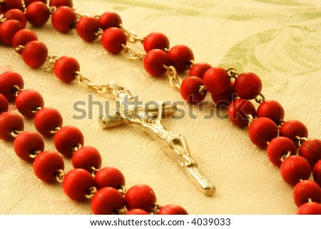 Symbolic religious object of red rosary with crucifix - stock photo