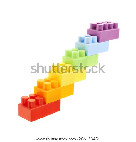 Symbolic stairway made of six colorful plastic toy construction bricks, isolated over the white background - stock photo