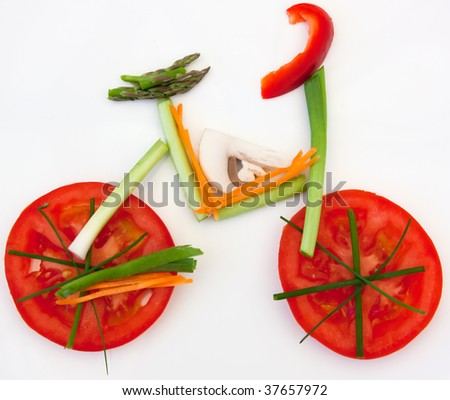 Symbolical bicycle made of vegetables as symbol and sign for vitality and healthy lifestyle - stock photo