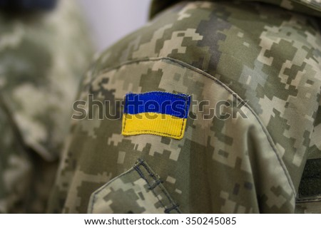 Symbolism of a Ukrainian flag on the uniform. Army - stock photo