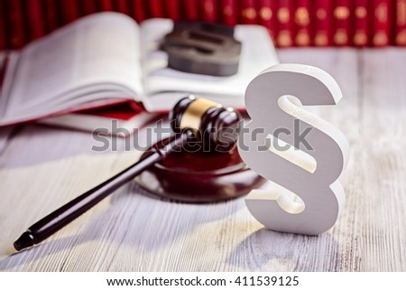 Symbols of law in court  library. Judge gavel, wooden paragraph and legal codes. Law concept - stock photo