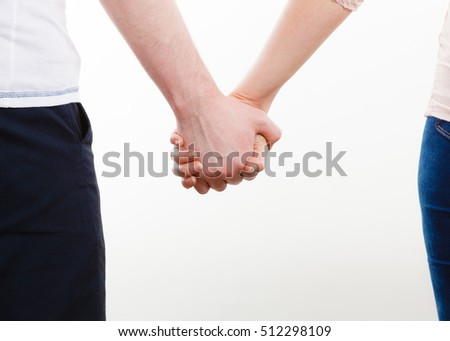 Symbols of love. Couple showing their connection and feelings by holding their hands strongly. Body language as expression of mind state.