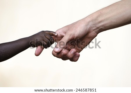 Symbols of Peace: Helping Hand for African Children Togetherness - stock photo
