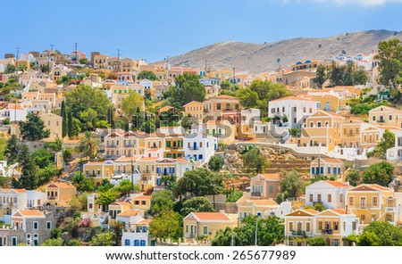 SYMI, GREECE - AUGUST 02, 2014: Colorful Houses of Symi Island and docked Boats on August 02, 2014 on Symi island, Greece.