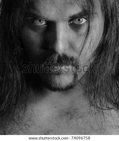 Symmetric black and white portrait of a young man with long hair - stock photo